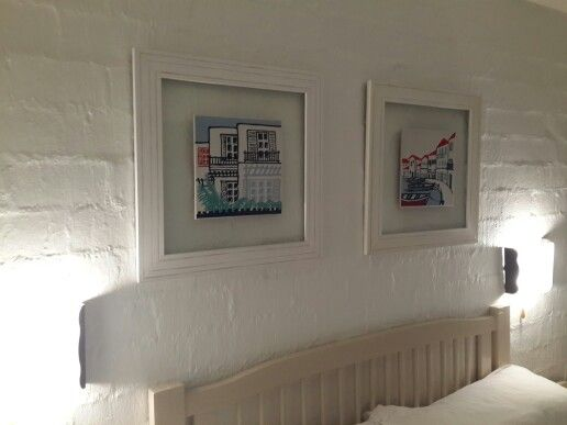 Complimentary pictures frames in the #bedroom of a #Greek-styled Kaliva of Mykonos. #HomeDecor