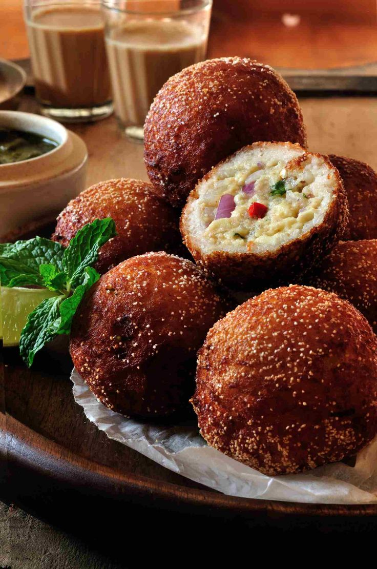 Paneer Stuffed Bread Fritters Recipe is a delicious party appetiser and tea time snack. Super crisp deep fried fritters stuffed with paneer bhurji theyre perfect for entertaining a crowd over a cup of chai or to kick off a party. Easy to throw together and they taste best when eaten freshly made serve these Paneer Stuffed Bread Fritters with Pudina Chutney as an appetiser or with Ginger Cardamom Chai to perk up your tea time.