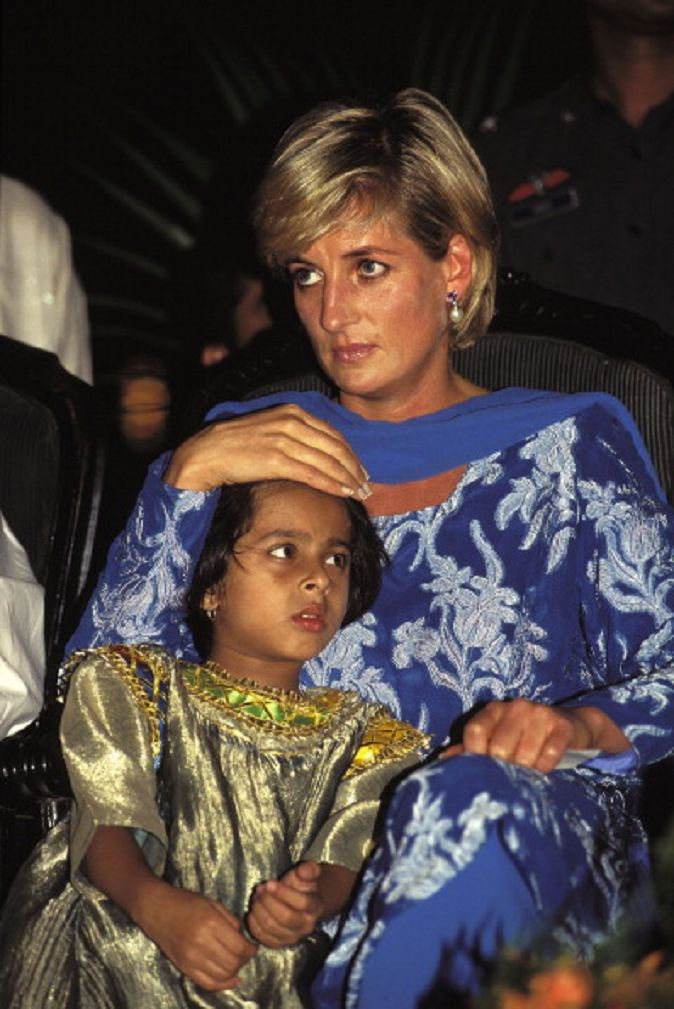 May 23, 199 :Princess Diana holds a Pakistani child suffering from cancer at the launching of a new fund-raising campaign for former cricket star Imran Khan's charity cancer hospital in Lahore.