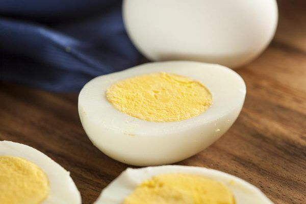 Halved hard boiled eggs on countertop.