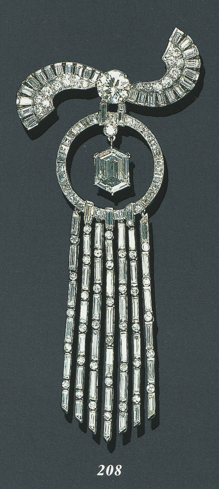 AN ART DECO DIAMOND PENDANT BROOCH, CIRCA 1930. Centring upon a hexagonal-cut diamond, suspended by a diamond collet from a calibré-cut diamond independant frame, enhanced by a pavé-set, baguette and circular-cut diamond scroll motif surmount and a seven-strand baguette and circular-cut diamond tassel, mounted in platinum.