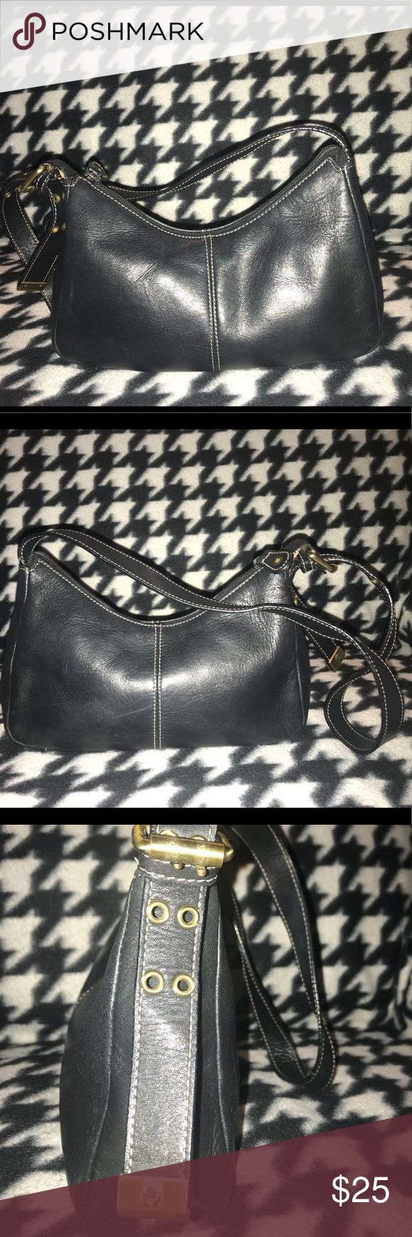 Etienne Aigner Black leather shoulder bag Beautiful, moderately used small black leather shoulder bag with white top stitching and brushed gold hardware. Soft leather, good condition a few scratches on the bottom. Adjustable strap. 2 open interior pockets, 1 zippered pocket. Etienne Aigner Bags Shoulder Bags