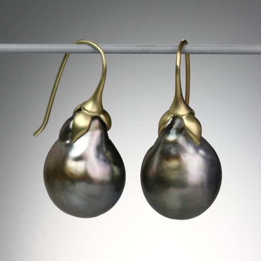 "A pair of 18k gold ""Eggplant"" earrings with dark Tahitian pearls. Total length is 1.25""."