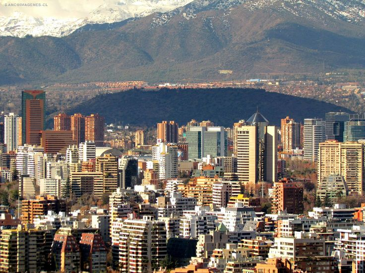 Santiago, and behind,  the Andes mountains