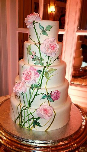 I love the painted effect of this cake with the sugar roses made to give it depth. Just a shame they didn't mount it onto a covered board which I think would have finished it off.   Aviary-Edited Photo by Elizabeth Forkey