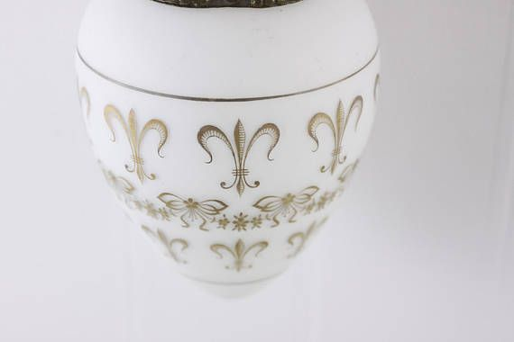 A beautiful Vintage French lamp, this vintage milk glass pendant light has been hand painted with the iconic Fleur de Lys pattern, symbol of the French Royal house. A simple yet elegant ceiling light, this item would look fantastic in your American farmhouse or midcentury home decor. Dates ca 1910-1920s.