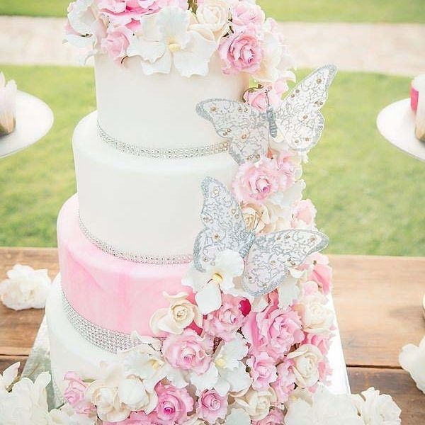 Pink & Gold Wedding Cake with Cascading Flowers but gold butterflies instead