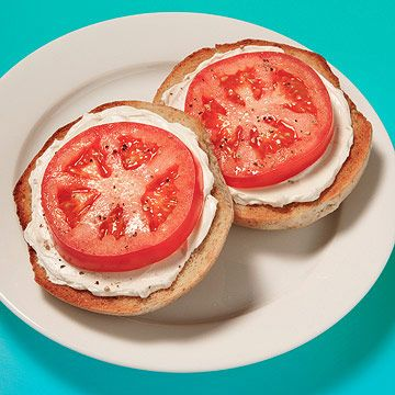 Bagel & Cream Cheese With Tomato- 1 3 - ounce small whole-grain bagel 2 tablespoons low-fat cream cheese 2 large slices tomato salt, to taste pepper, to taste