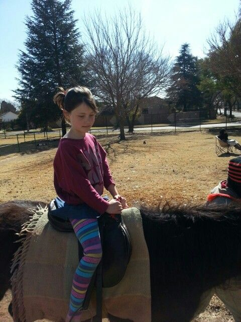 She looks good on a horse.