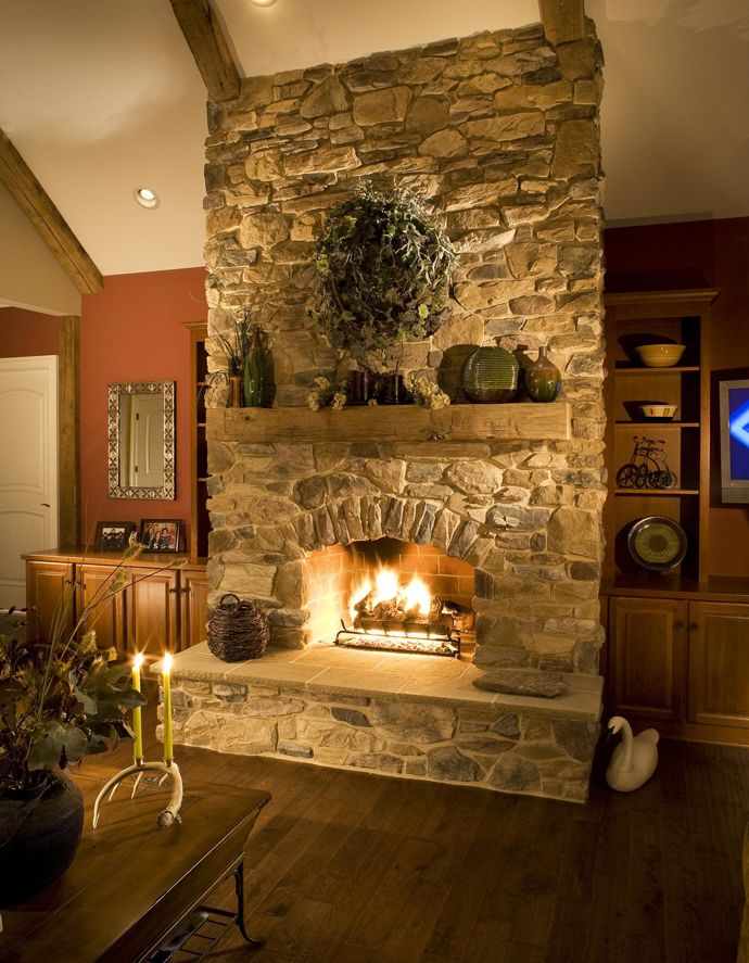 25 stone fireplace ideas for a cozy nature inspired home home rh pinterest com Stacked Stone Fireplace Ideas stone fireplace decorating ideas photos