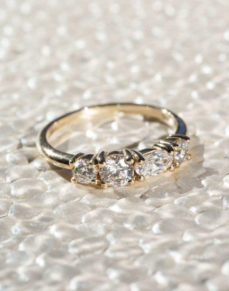 The Linear Diamond Ring. This ring says forever without the trappings of tradition– a diamond doesn't have to be a whopper to have impact, favoring instead to have a comfortable, low-set array of stones in various cuts and sizes.