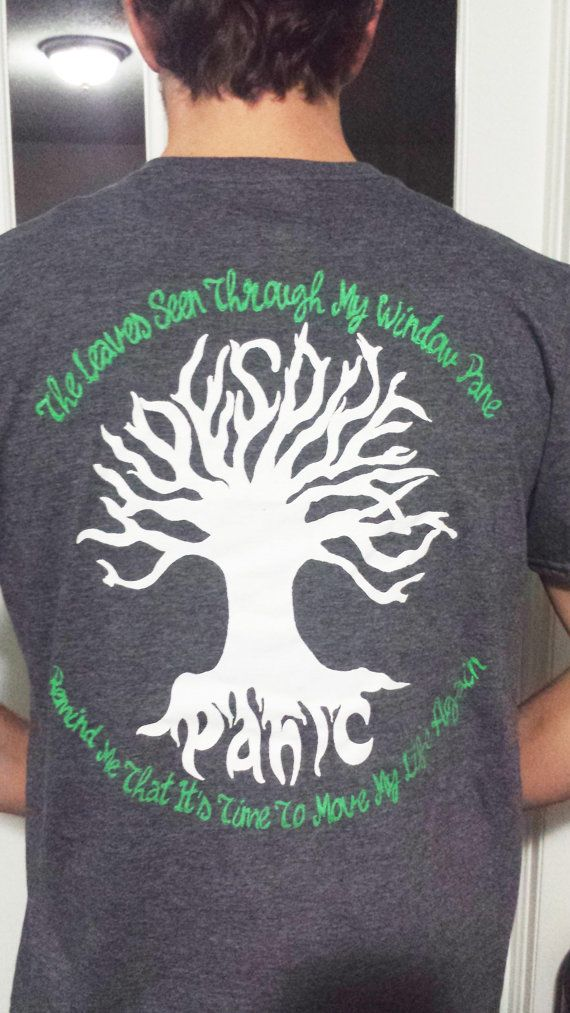 "Widespread Panic Tee Shirt - WSP - Charlotte NC for N:YE this year!! Widespread in the limbs of the tree, Panic in the roots, Driving Song lyric ""The leaves seen through my window pane remind me that its time to move my life again"""