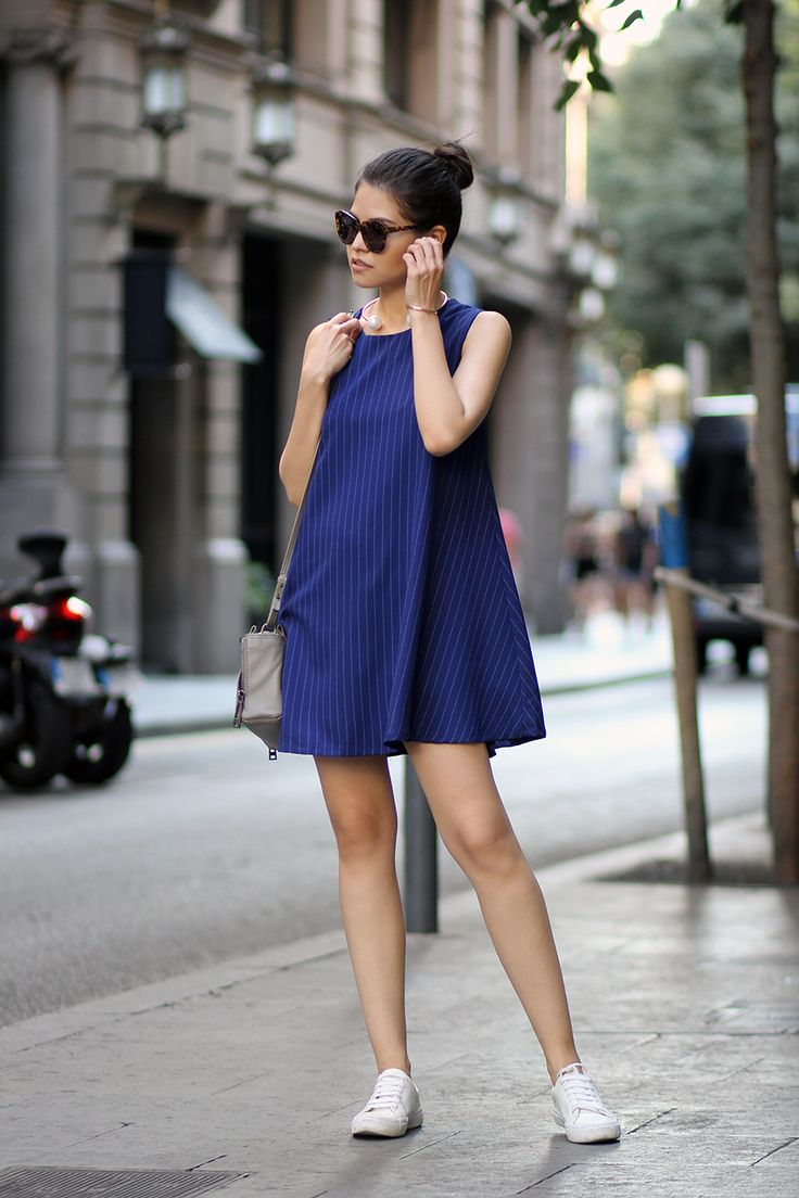 justthedesign: Vertical striped A-line dress and simple white sneakers. Via Adriana Gastélum Dress: Ninth Collective Sneakers: Stradivarius Bag: Botkier. Vertical Striped Dress Outfit