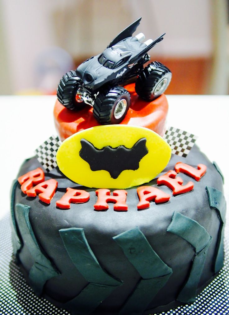 Batman Monster Truck Cake. Inside is a checkered cake inspired from Baker's Corner https://www.bakers-corner.com.au/recipes/cakes/chocolate/vanillia-and-chocolate-checkerboard-cake/