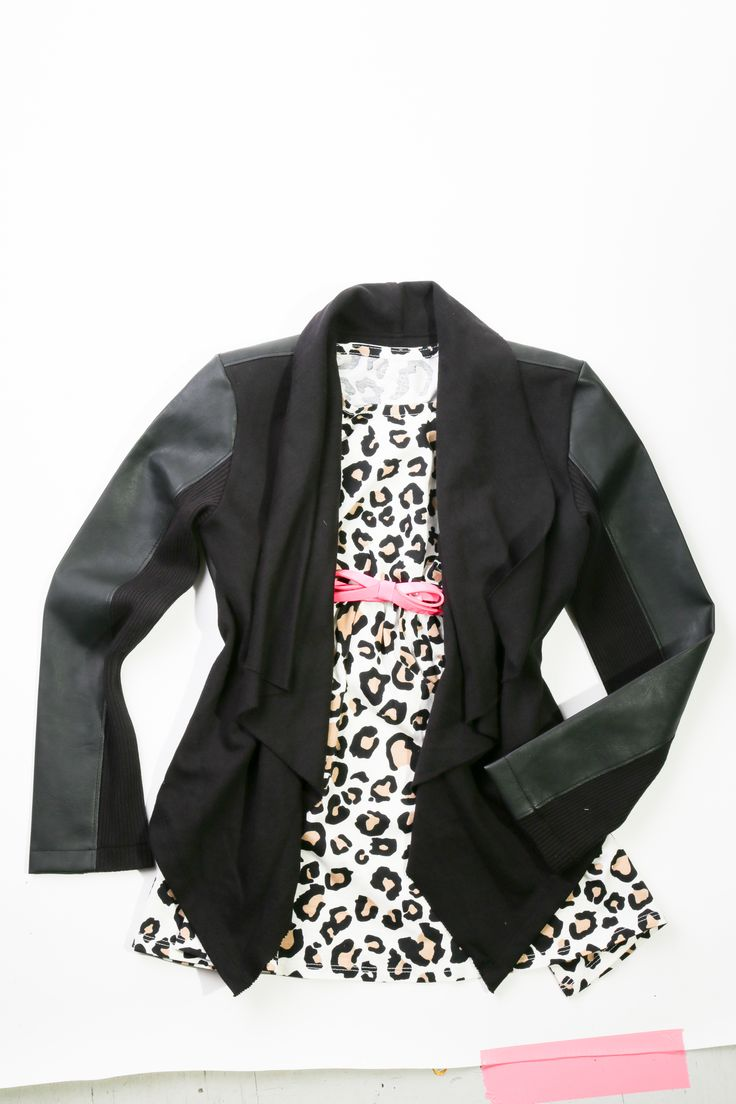 Black pleather cardigan, $39.95 with a tan dress with bright pink bow belt, $29.95 at The Children's Place. - So Cute! Looks like a little tuxedo jacket <3