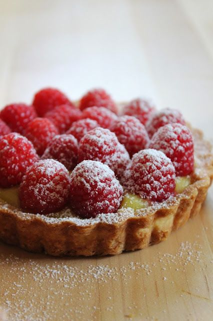 Raspberry Tartlettes on a bed of either lime curd or salted dark chocolate ganache