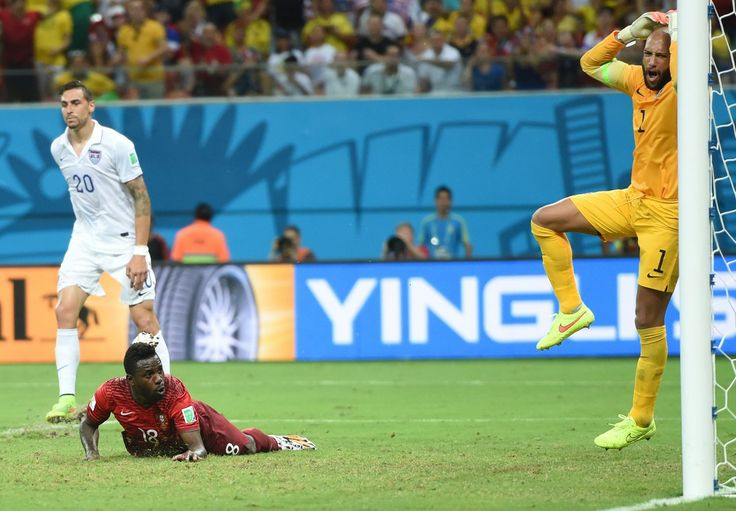 U.S. Stunned By Last-Minute Portugal Goal In World Cup Thriller - US goalkeeper Tim Howard (R) reacts after goal from Portugal's forward Silvestre Varela (2nd L) during a Group G match between USA and Portugal at the Amazonia Arena in Manaus during the 2014 FIFA World Cup on June 22, 2014. AFP PHOTO / FRANCISCO LEONG (Photo credit should read FRANCISCO LEONG/AFP/Getty Images)
