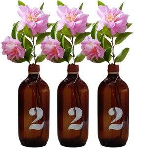 Flowers in bottles: Numbers Bottles Vas, Brown Bottle, Vases, Numbers Ideas, Numbers Bottlesva, Tables Numbers, Custom Numbers, Numbers Bottle Vas, Table Numbers