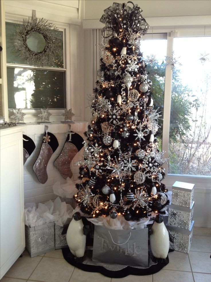 Best 25 black christmas trees ideas on pinterest black for White and gold tree decorations