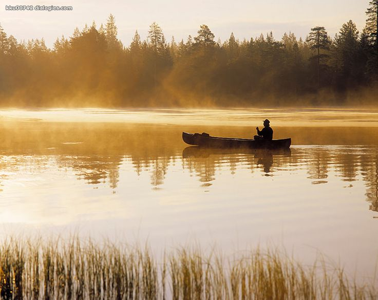 Rowing a boat in a silent lake. Hossa. Suomussalmi. Finland