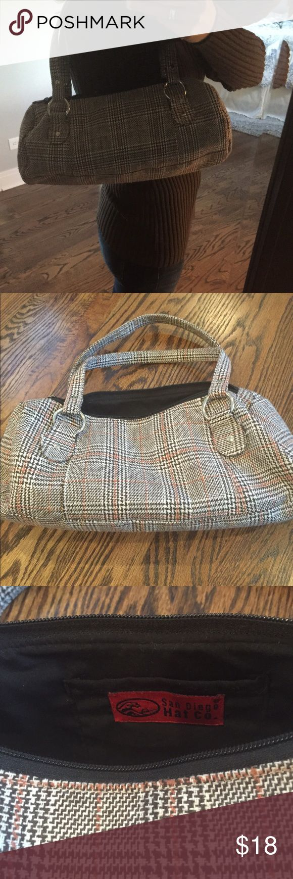 Brown plaid purse Carry something that stands out this fall!  This plaid bag combines falls best colors - cream, brown and orange.  It is a roomy satchel style with one small interior pocket.  Purchased at a small store in Chicago. In excellent used condition. San Diego Hat Company Bags Satchels