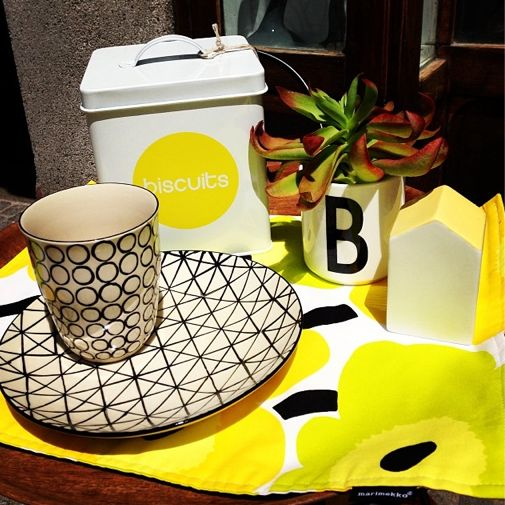 Nice little arrangement in Front of the shop. I love bright yellow these sunny days :) @Bloomingville - ever changing homes - ever changing homes @Aino F Ahlnäs @DESIGN LETTERS www.nord-design.at