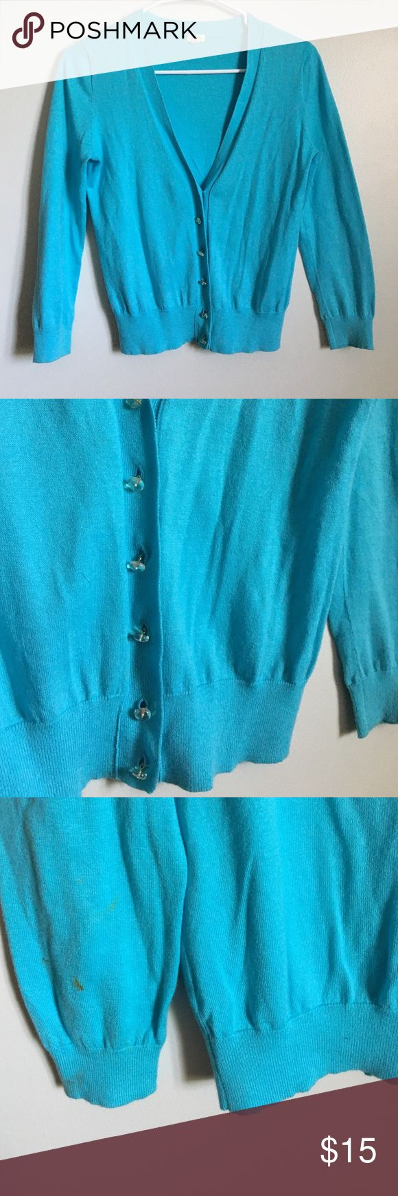 J.crew turquoise cardigan w crystal clear buttons Turquoise Cardigan from J.crew. V-neck style with crystal clear buttons. I did find a small stain on the back of one oft sleeves when listing but I have not tried to remove it- I feel pretty confident that it will come out. This is a perfect weight cardigan for spring and summer! J. Crew Sweaters Cardigans