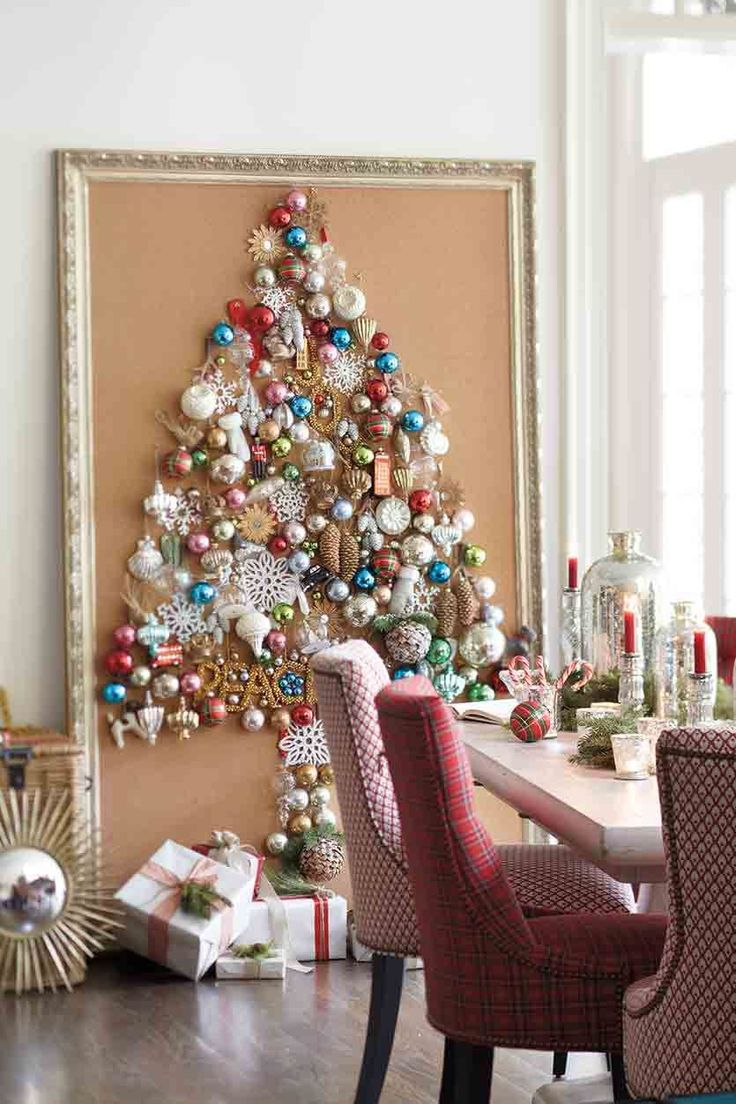 Save floor space and hang ornaments on the wall or cork board for a faux-tree.  Whether you have a tree or not, think outside the box and find different ways to display your ornaments for extra sparkle. We dreamed up this spectacular one-dimensional tree using our collection of ornaments — and made clever use of wall space.