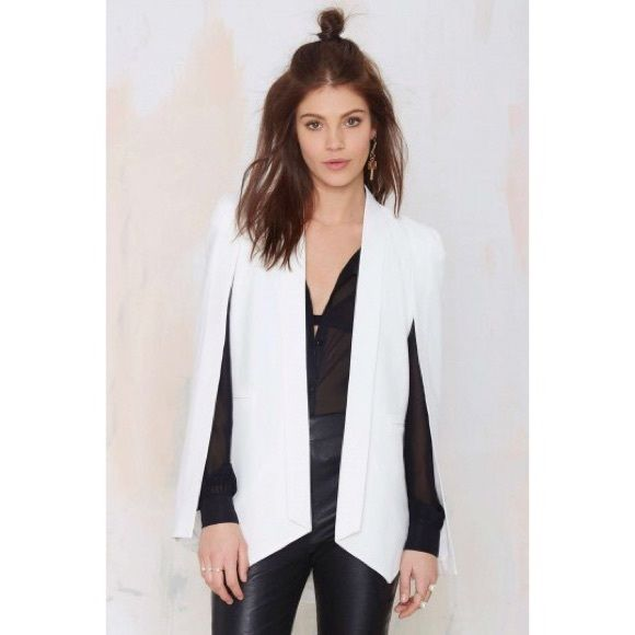 Nasty Gal Champagne Taste Cape Blazer - Ivory You don't have to be a superhero to wear a cape. This ivory cape blazer features slit sleeves and a pointed hem. Fully lined. Looks perfect with a simple tank dress and minimal sandals. Time to take over the world. By Nasty Gal. Nasty Gal Jackets & Coats Blazers
