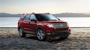 2013 Ford Explorer.  The tow package would be a check in the 'plus' column.  There's also seating for 7.