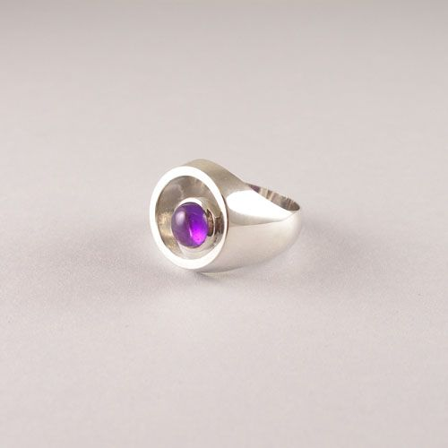 Handmade .925 Sterling Silver ring with a cabouchon Amethyst. This is a very unique design.