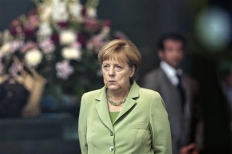 German Chancellor Angela Merkel arrives for the welcoming ceremony of the Prime Minister of Serbia Aleksandar Vucic for talks at the chancellery in Berlin, Wednesday, June 11, 2014. (AP Photo/Markus Schreiber) ▼14Jun2014AP Merkel quiet on WCup winner ahead of Germany game http://bigstory.ap.org/article/merkel-quiet-wcup-winner-ahead-germany-game #Angela_Merkel