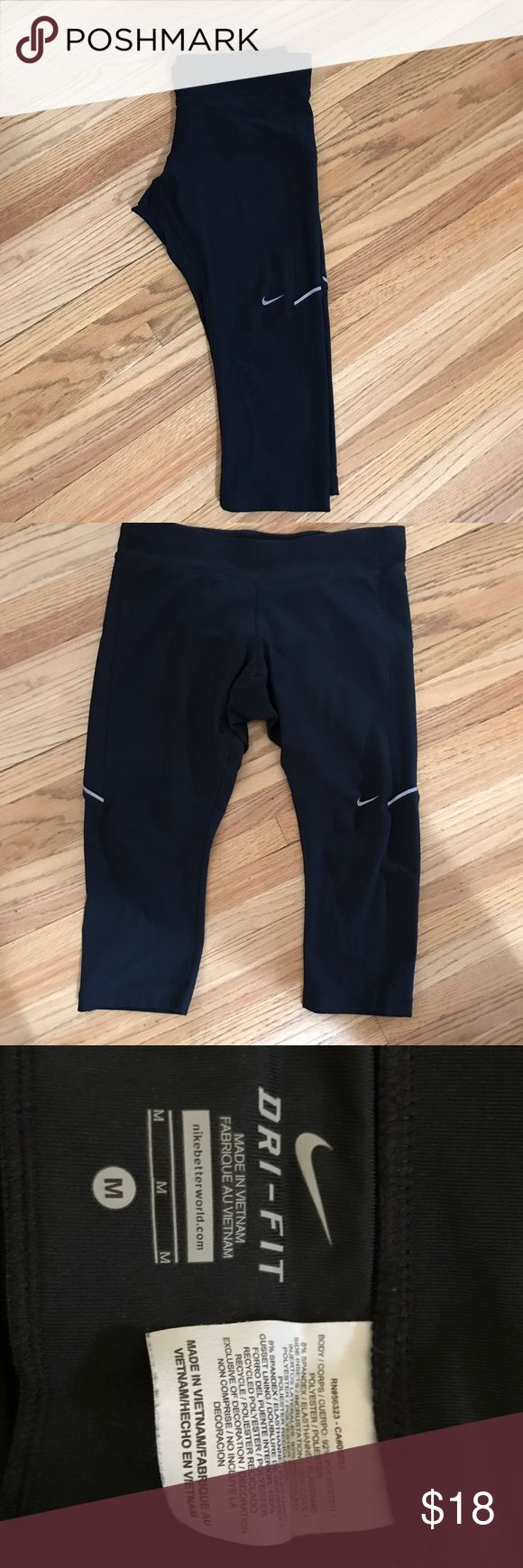 Nike dry fit Capri running tights size medium Nike dry fit Capri running tights size medium. Come a few inches under knees for length. Very good condition. Back zip pocket on waist band Nike Pants