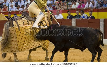 ALMENDRALEJO, SPAIN, AUGUST 15: The lancer wounding the bull on the bulllfight lance third, on August 15, 2009 in Almendralejo, Spain