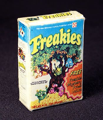 """Here's an idea.. print, cut out, and put together a """"papercraft"""" version of the mini Freakies cereal box shown above. Povided below is all you need to make ..."""