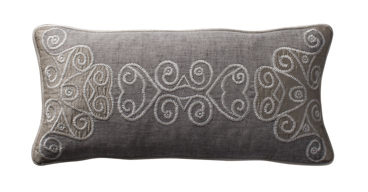 Celtic triskeles; intricate silk appliqué and thread embroidery on linen. Aztaro cushion £165 | Available from http://www.luxdeco.com/brands/aztaro