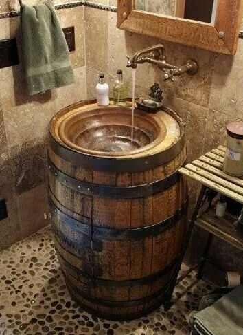 If we turn a barrel into a cabinet (cut the door out, simple handle/hinge/shelves, put a lifted sink on top. Fits with the barrel tub theme, so gorgeous :)