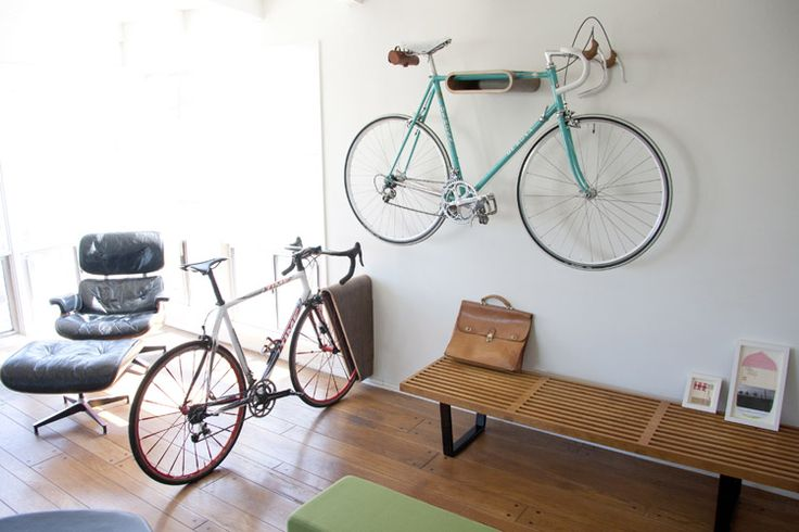Very Nice Bike Rack - The Very Nice Bike rack comes in 2 versions, a wall mount and floor stand. The wall mount is best suited for horizontal top tube bikes weighing in at 25 lbs or less. The floor stand will hold just about any bike, and comes with felt spacer pads to accommodate various tire widths. Bent plywood / walnut veneer / white powder coated steel hardware.