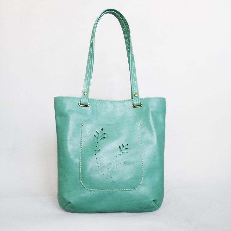 Turquoise leather tote bag, perfect for your summer outfit! Simple, but elegant design and very lightweight, I designed it to be your perfect everyday bag. It is crafted of quality Italian cowhide and double stitched for extra durability. Hand cut decoration on the front pocket.  No lining inside.  Your perfect summer accessory!  The bag will be shipped by registered, priority mail.