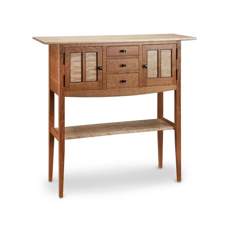 Free Shipping. Tom Dumke of Thomas William Furniture creates this Cherry Foyer Sideboard Table. It's made of solid cherry with flamed birch and wenge accents. this outstanding design has generous storage. There are three drawers along with two side doors with one shelf inside. The drawer boxes are made with soft maple and aromatic cedar, dovetail joinery. The finish is two coats of lacquer. Handmade in the USA.