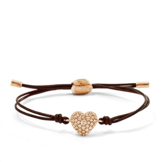 Our sweetest addition to your bracelet stack? A peach crystal heart strung on a luxe chocolate leather band.