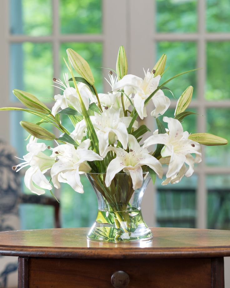 14 best office flowers images on pinterest silk flowers floral real touch large white lily centerpiece with blades of tall grass mingled in unopened lily buds in glass vase mightylinksfo
