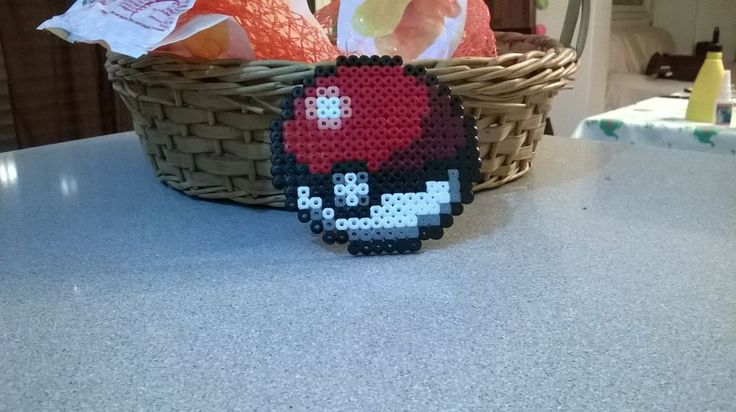 Perler Beads Pokeball via Makery. Click on the image to see more!