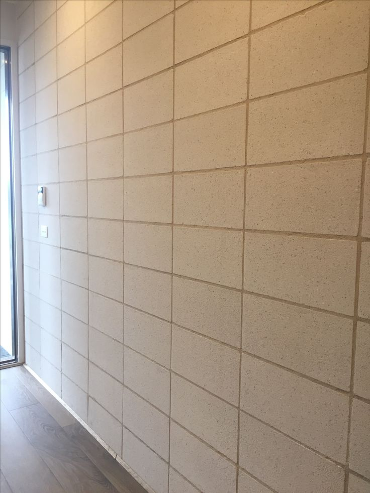 Photo 1: concrete blocks used as a interior wall at display home by Simonds@Epping sales centre looks durable.
