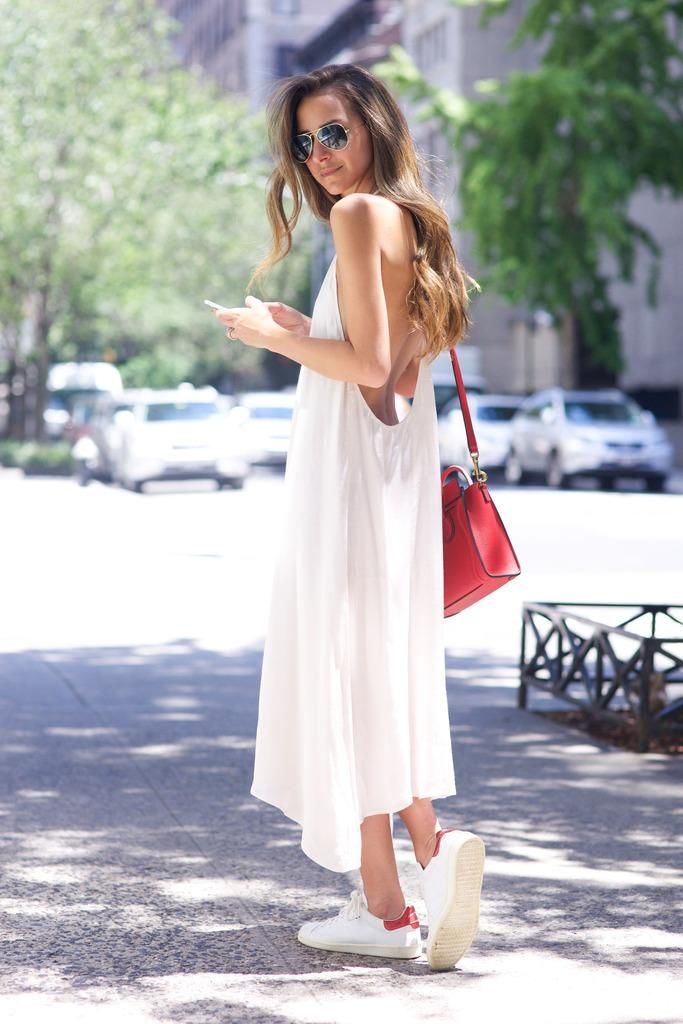 How to Style Your Sneakers in Summer - easy midi length white slip dress style with a red leather bag + clean white sneakers