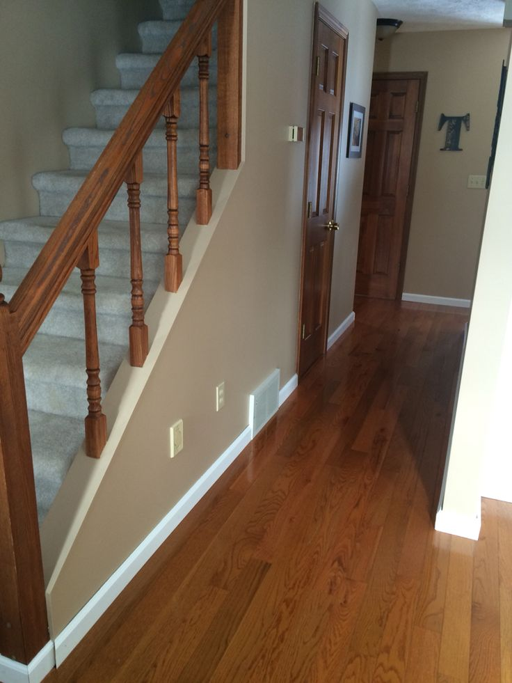 Oak doors, white baseboards, and Behr Toasted Wheat paint