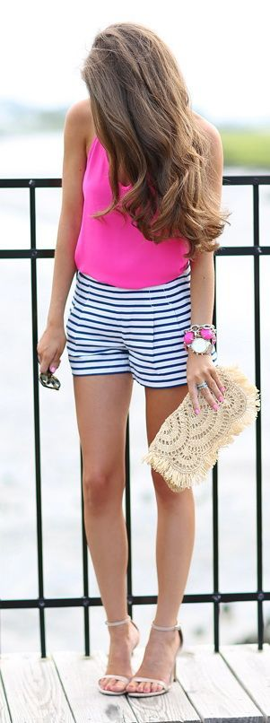 A cute summer outfit with striped shorts and a neon pink top.  Consider pairing a neon shirt with any preppy shorts to give the outfit a little more edge.  This pink neon shirt would also look great paired with traditional navy chino shorts for a more traditional summer outfit.