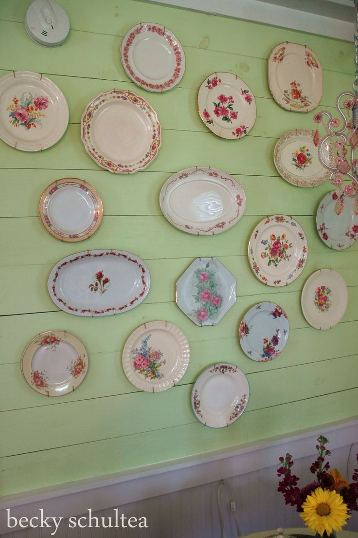 a wall of vintage china plates