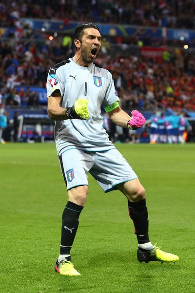 Gianluigi Buffon of Italy celebrates his team's first goal during the UEFA EURO 2016 Group E match between Belgium and Italy at Stade des Lumieres on June 13, 2016 in Lyon, France.