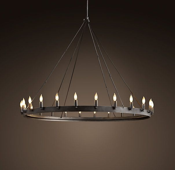 """CAMINO ROUND CHANDELIER MEDIUM $895 Rustic in style, simple in form and grandly sized, our hand-forged chandelier designed by industrial blacksmith Jon Sarriugarte makes an elegant statement. Drawing inspiration from early 20th century industrial fixtures, it's built of stout angle iron. DIMENSIONS Overall: 50¼"""" diam., 43""""H Steel Rods: one 6"""" and three 12"""" (included) Ceiling Plate: 5½"""" diam.; 1¼""""H Weight: 35 lbs."""